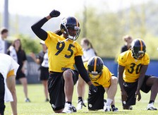 Jarvis Jones stretches at OTA's with the rookie class of 2013