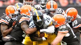 Steelers running back Le'Veon Bell burrows through a host of Browns defenders
