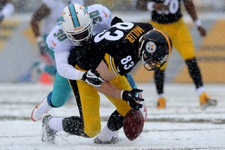 Sure handed tight end Heath Miller gets stripped after a crucial third down reception